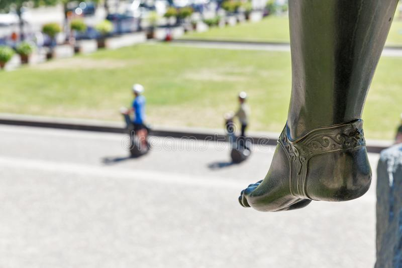Statue heel in front of Altes museum in Berlin, Germany. Warrior statue heel at the entrance to Altes Museum in Berlin, Germany. Lustgarten park in the stock photo