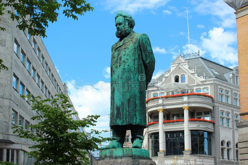 Statue of Henrik Ibsen in Oslo, Norway. Oslo, Norway - June 26, 2018: Statue of Henrik Ibsen in front of the Oslo`s National Theater. Norway`s main arena for stock image