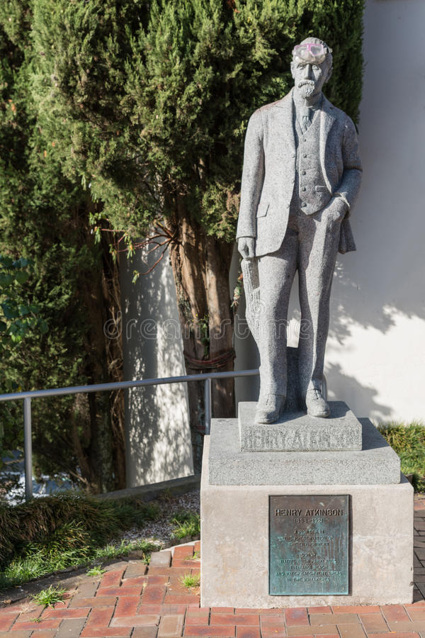 Statue of Henry Atkinson in Titirangi, New Zealand. Auckland, New Zealand - March 2, 2017: Gray stone statue of Henry Atkinson, environmentalist, standing on royalty free stock photos