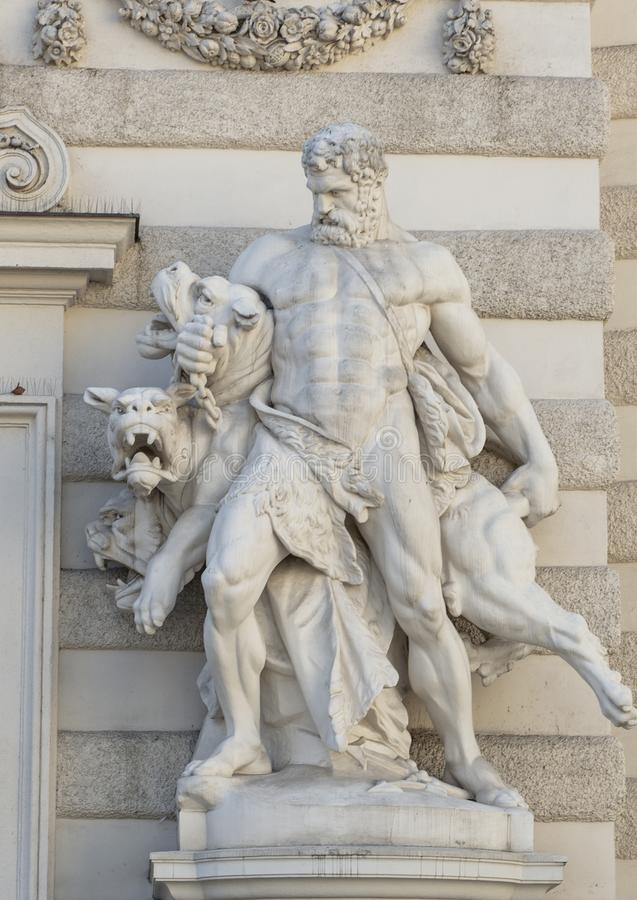 Statue of Hercules capturing Cerberus at the Michaelerplatz entrance to the Michaelertrakt at the Hofburg Palace, Vienna. Pictured is a marble statue of Statue royalty free stock images