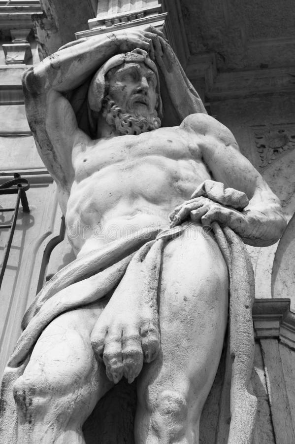 Statue of Hercules at the entrance to the 18th century Palazzo Vescovile Bishops Palace in the historical center of Mantua,. Italy royalty free stock photos