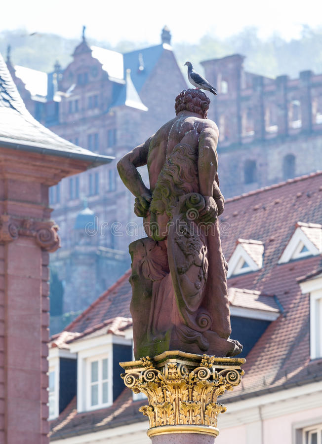 Statue of Hercules in market square Heidelberg Germany. Statue of Hercules erected in 1703 in Market Square by Rathaus in old town city of Heidelberg Germany stock photo