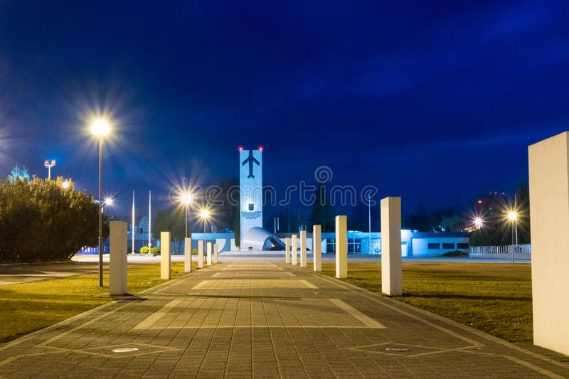 Statue of Heroic Aviators at night. Deblin, Poland - February 20, 2019: Statue of Heroic Aviators at night royalty free stock photography