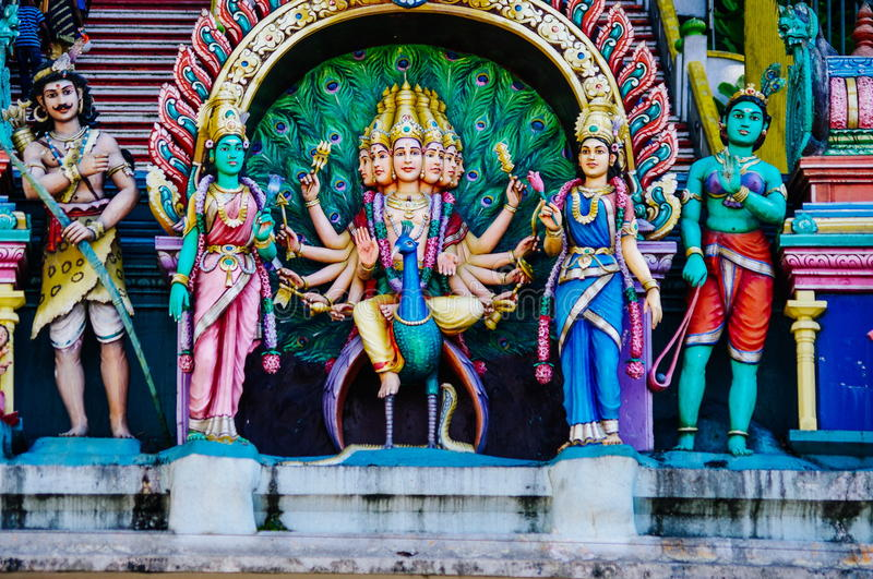 Statue Hindu deities on the roof of temple within Batu Caves. Batu Caves - a complex of limestone caves in Kuala Lumpur, Malesia royalty free stock photos