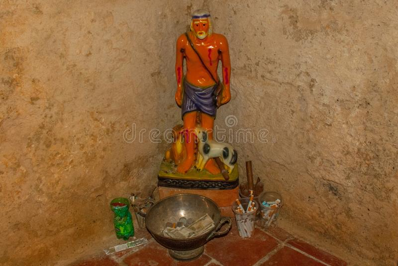 Statue of the Holy Church in the Fortress Fortaleza de Jagua. Castillo de Jaguar. Cuba, Cienfuegos. royalty free stock image