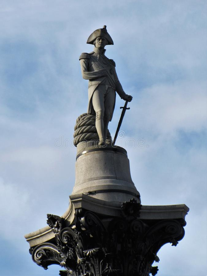 The statue honoring Lord Nelson stands watch over London royalty free stock images