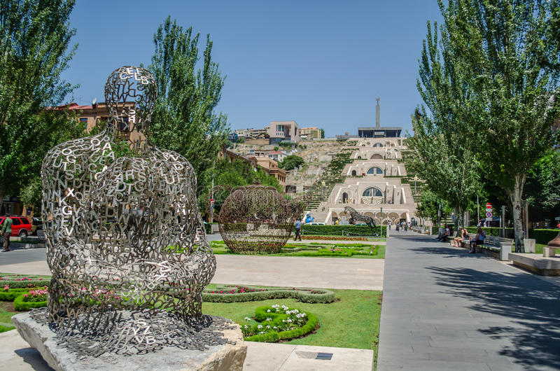 A statue of human near cascade in Yerevan, Armenia. Human statue made of letters in Yerevan, Armenia. In the view of cascade royalty free stock photography
