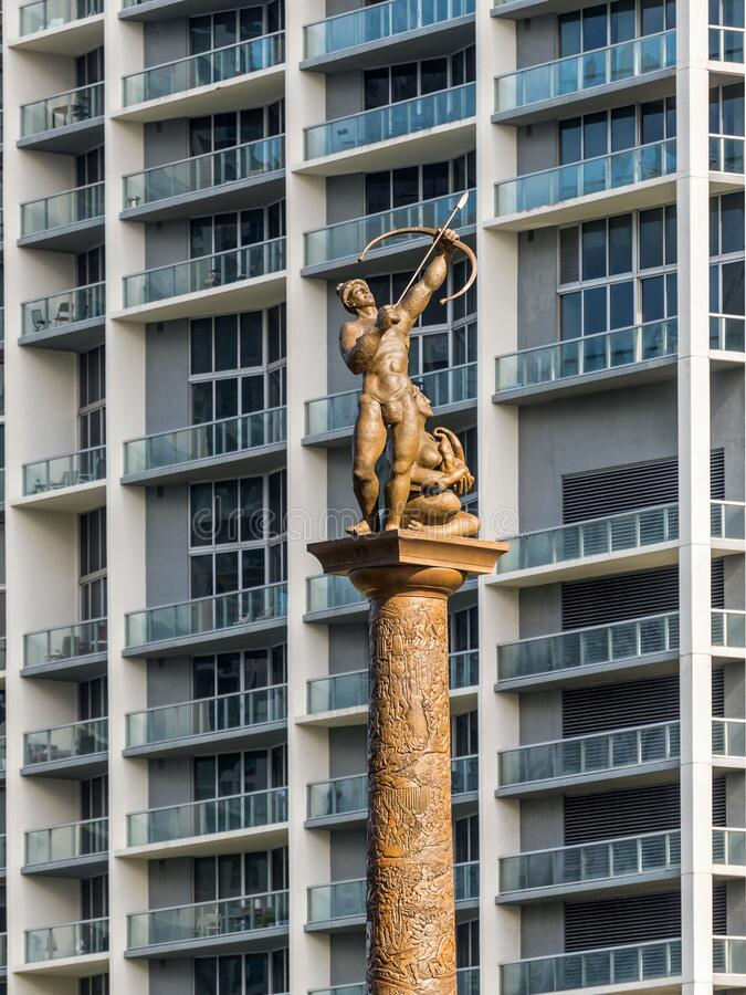 Statue of an Indian couple at Miami, Florida, United States of America. Miami, FL, United States - April 20, 2019: The Tequesta indians were the original stock photos