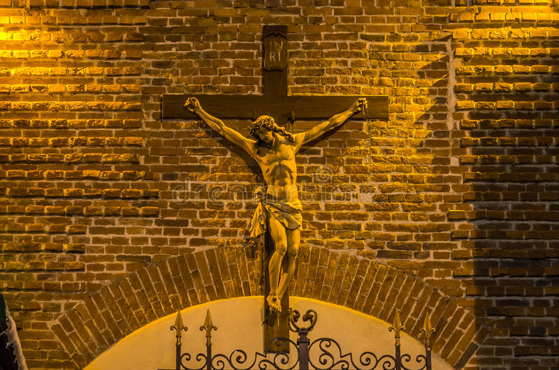 Statue of Jesus Christ crucifixion on a brick wall background royalty free stock images