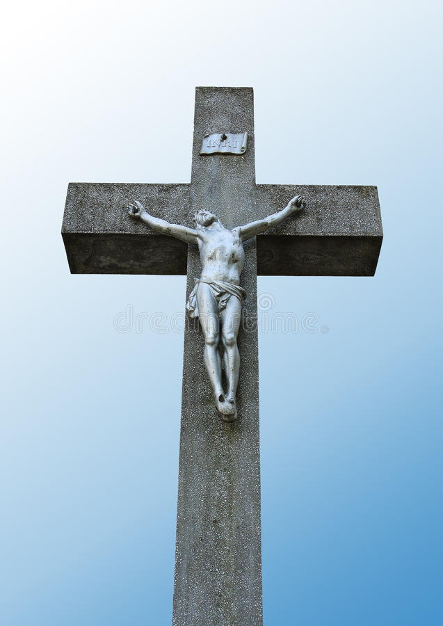 Statue of Jesus on a stone cross stock photo
