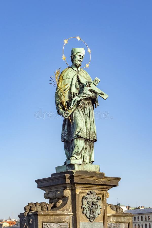 Statue of John of Nepomuk on the Charles bridge in Prague royalty free stock photos