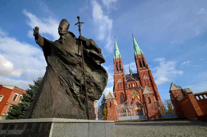 Statue of John Paul IIl Rybnik, Poland. Statue of John Paul II against the background of the cathedral Rybnik, Poland stock photo