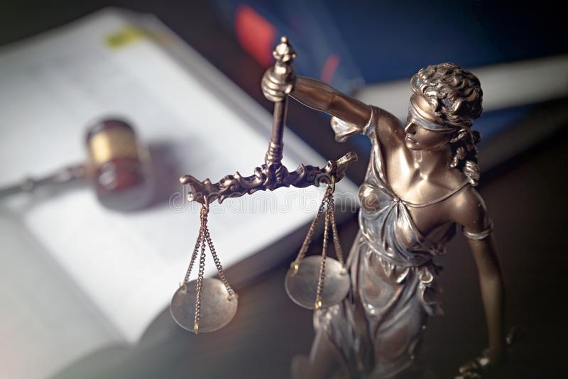 Statue of justice on books background. Lady justice, themis, statue of justice on books background. Law concept with justice figurine in library royalty free stock photo