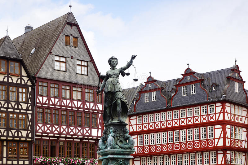 Statue of Justice. Frankfurt am Main, Germany. Statue of Justice on background old fachwerk houses royalty free stock photography
