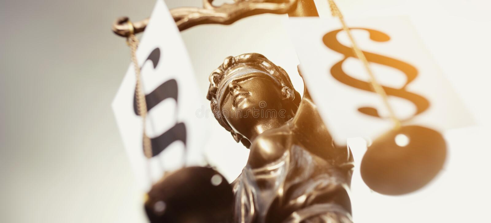 The Statue of Justice. Justitia the lady of Justice with paragraph signs on scales view from above with shine effect. ideal for websites and magazines layouts stock photo