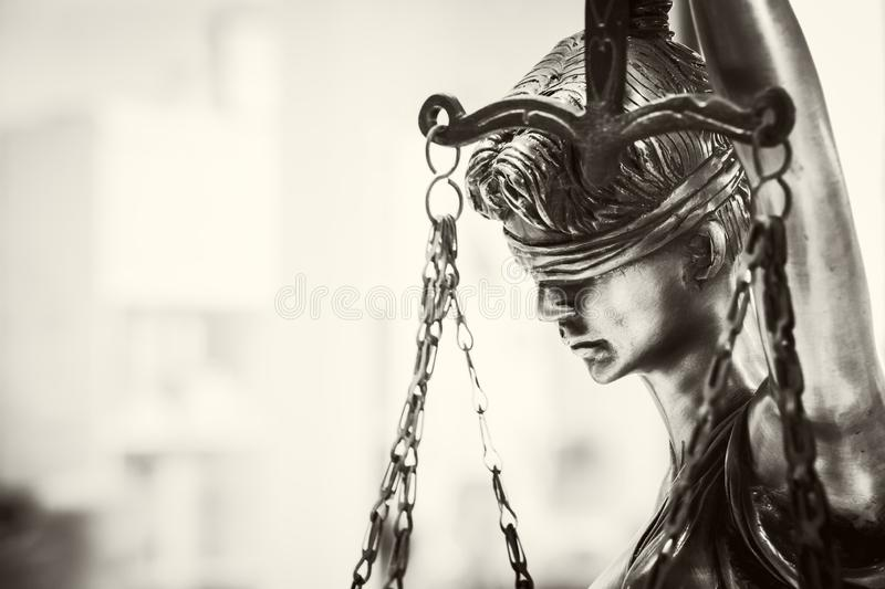 Statue of justice. Lady justice. The Statue of Justice - lady justice or the Roman goddess of Justice. monochrome image stock photo