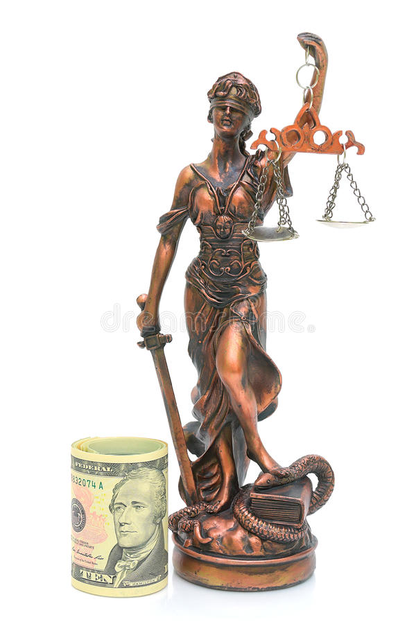 Statue of justice and money on a white background. Statue of justice and money (U.S. dollars) is isolated on a white background close-up royalty free stock image