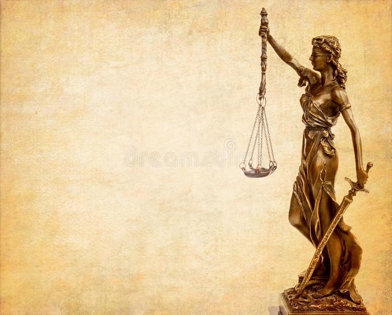 Statue of justice on old paper background stock photography