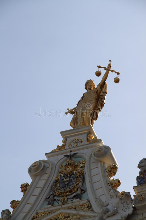 The statue of justice on roof of building. Brugge royalty free stock photos