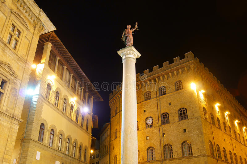 The statue of justice in the square in Florence. Night view of the area of Florence with the statue of justice on a marble column royalty free stock image