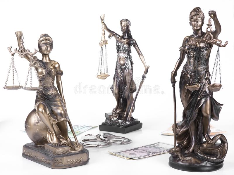 Statue of Justice Themis with money euros and dollars. Bribe and crime concept. Statue of Justice Themis with money euros and dollars. Bribe and crime concept royalty free stock images