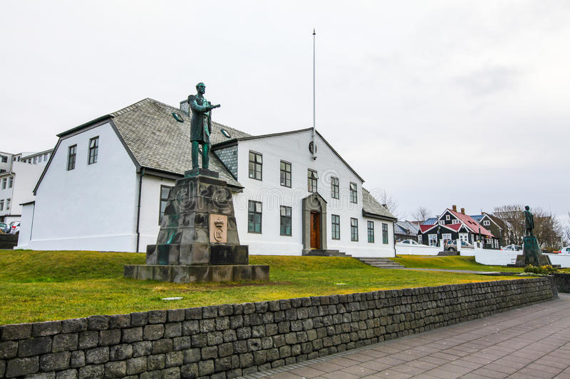 Statue of King Christian IX in front of Office of Prime Minister. In Reykjavik, Iceland at dull day royalty free stock photo