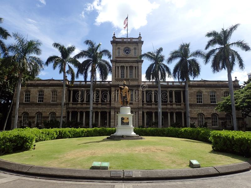 Statue of King Kamehameha in downtown Honolulu. Hawaii.  statue stands prominently in front of AliÊ»iolani Hale with USA and Hawaii Flag flying above in stock image