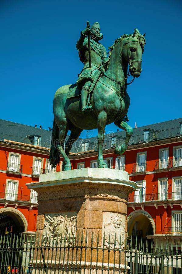 Statue of King Philip III at the Plaza Mayor square in Madrid. Bronze equestrian statue of King Philip III at the Plaza Mayor square and old buildings in Madrid stock image