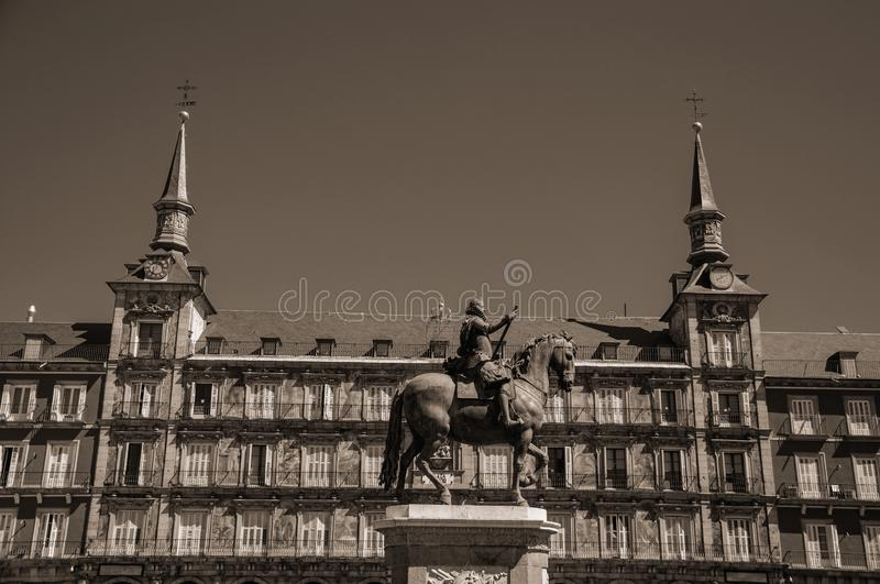 Statue of King Philip III at the Plaza Mayor square in Madrid. Bronze equestrian statue of King Philip III at the Plaza Mayor and old buildings in Madrid stock photography