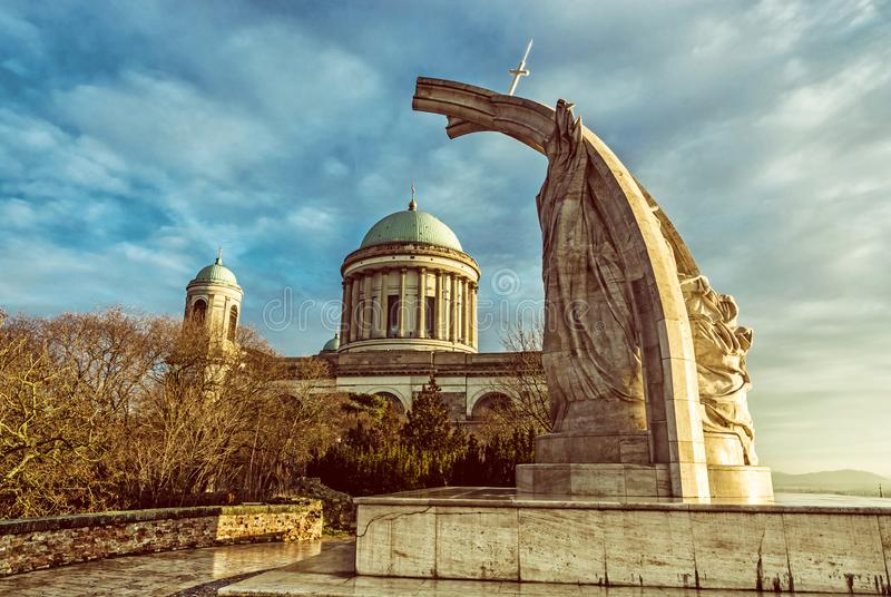 Statue of King Saint Stephen and basilica in Esztergom, Hungary. Statue of King Saint Stephen and monumental basilica in Esztergom, Hungary. Sunset scene. Travel stock images