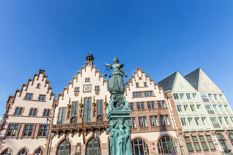 Statue of Lady Justice, fountain of justice in front of the Rome. R in Frankfurt stock image