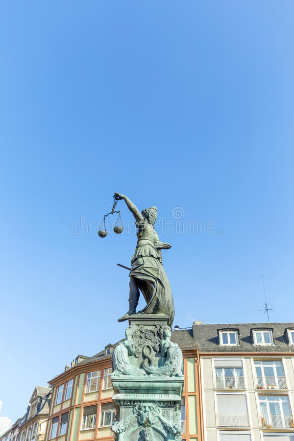 Statue of Lady Justice, fountain of justice in front of the Rome. R in Frankfurt royalty free stock photos