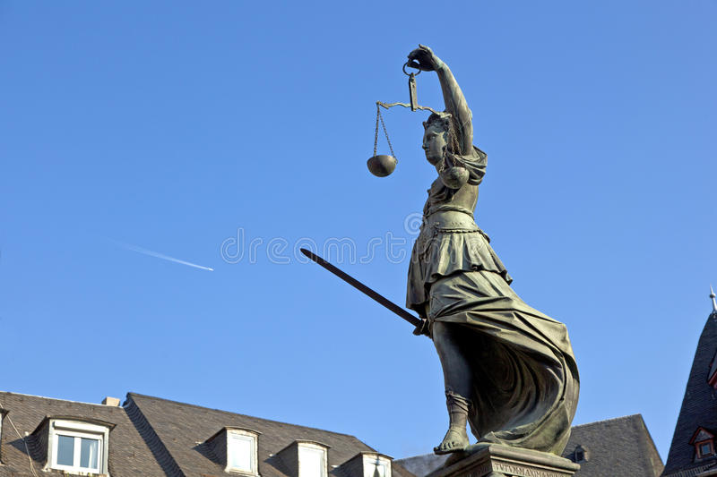 Statue of Lady Justice in front. Of the Romer in Frankfurt - Germany royalty free stock photo