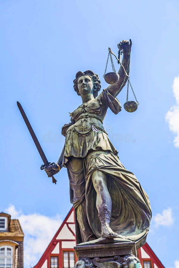 Statue of Lady Justice in front of the Roemer in Frankfurt. Statue of Lady Justice in front of the Romer in Frankfurt am Main - Germany royalty free stock photos