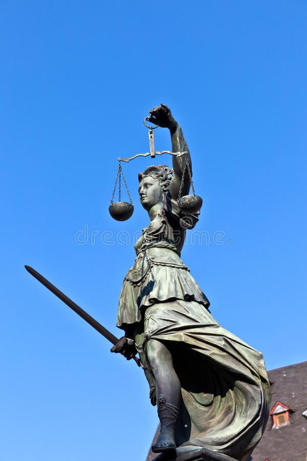 Statue of Lady Justice in front of the Romer. In Frankfurt - Germany royalty free stock images