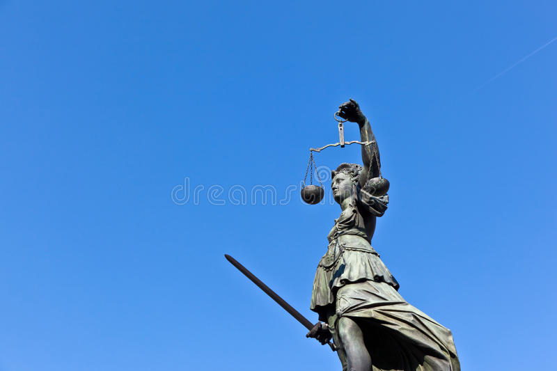 Statue of Lady Justice in front. Of the Romer in Frankfurt - Germany royalty free stock images