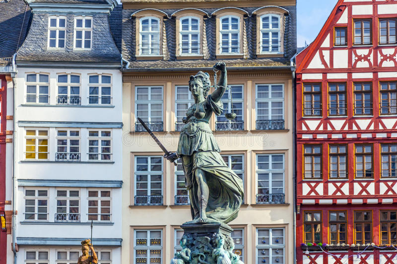 Statue of Lady Justice in front. Of the Romer in Frankfurt - Germany royalty free stock photos