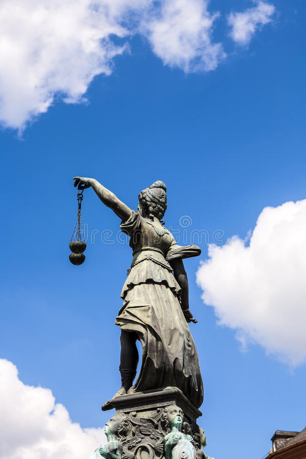 Statue of Lady Justice in front of the Romer in Frankfurt. Germany royalty free stock image