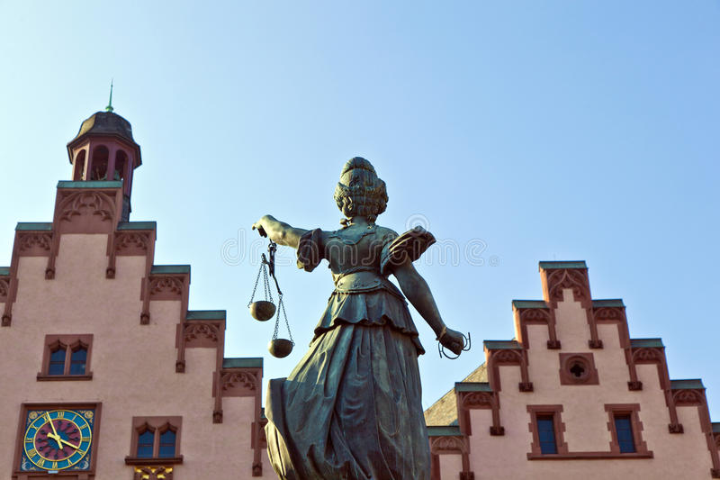 Statue of Lady Justice in front of the Romer. In Frankfurt - Germany stock photography