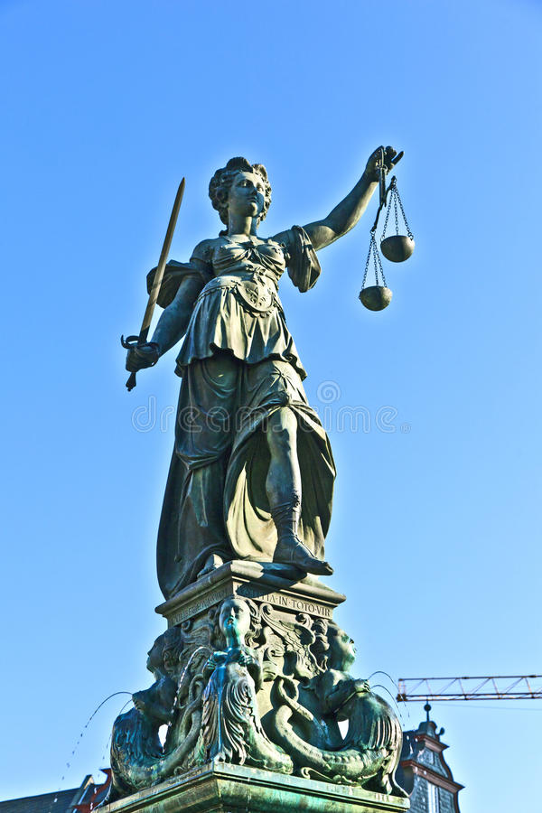 Statue of Lady Justice in front of the Romer in Frankfurt stock photos