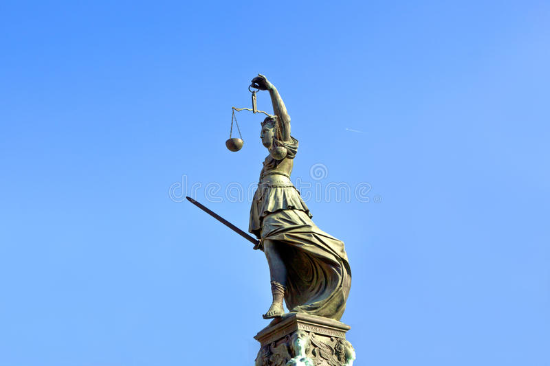 Statue of Lady Justice in front of the Romer. In Frankfurt - Germany royalty free stock photos