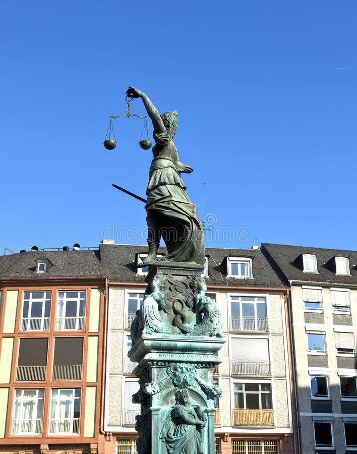 Statue of Lady Justice in front of the Romer. In Frankfurt - Germany royalty free stock image