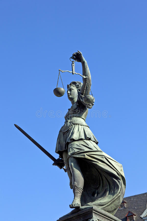Statue of Lady Justice in front of the Romer. In Frankfurt - Germany royalty free stock photo