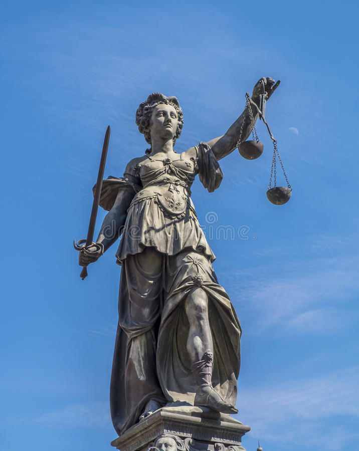 Statue of Lady Justice (Justitia) in Frankfurt. Justitia - Lady Justice sculpture on the Roemerberg squareStatue of Lady Justice (Justitia) in Frankfurt, Germany royalty free stock images