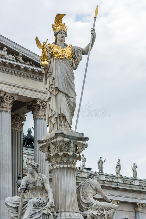 Statue of lady justice at parliament building Vienna. Sculpture of lady justice at the Austrian parliament in Vienna. The statue contains various golden elements royalty free stock photography