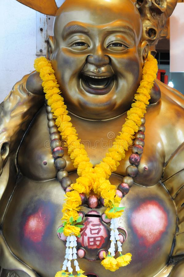 Statue of a Laughing Buddha royalty free stock photo