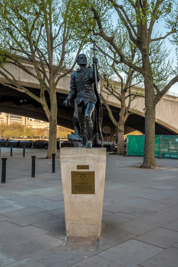 A statue of Laurence Olivier near National Theatre in South Bank, London royalty free stock photography