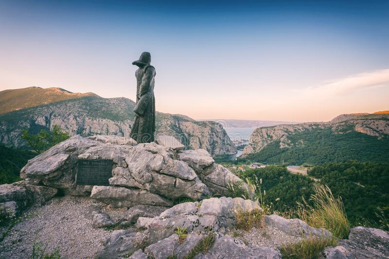 Statue of legendary Mila Gojsalic on top of a rocky mountain near Omis, Dalmatia, Croatia stock photos