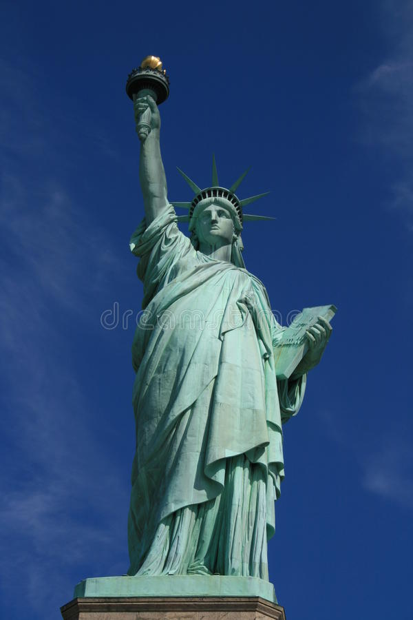 Statue of Liberty. The Statue of Liberty (Liberty Enlightening the World, French: La Liberté éclairant le monde) is a colossal neoclassical sculpture on stock image