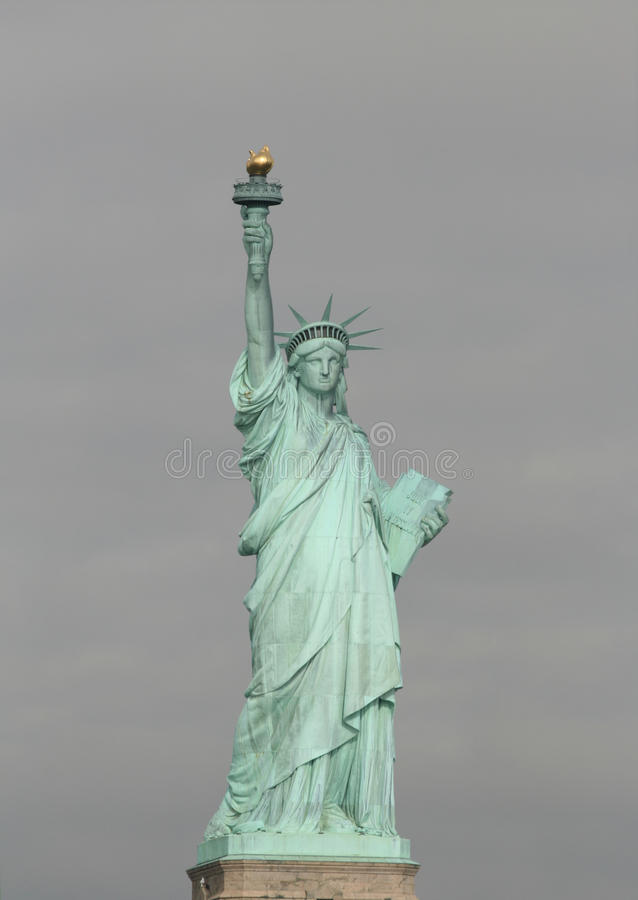 Statue of Liberty. The statue of liberty in New York USA on a cloudy day royalty free stock photos